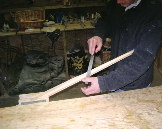 Nathan working on turning the stave into a bow. A minor error at this stage could reduce the performance of the bow or even marr it completely.